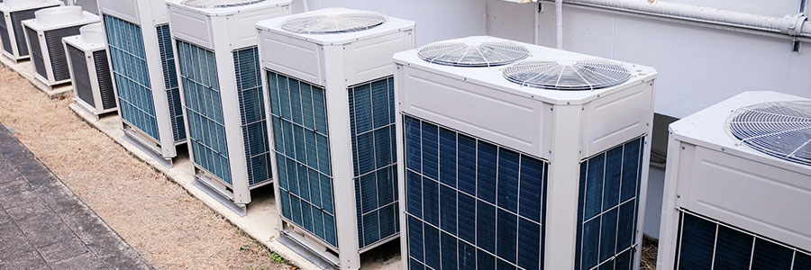 a row of commercial hvac units